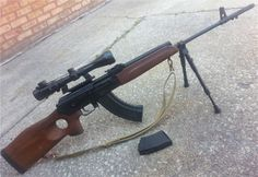 Saiga M  A very seldom seen Saiga variant that was available in .308 Winchester and 7.62x39mm. It has a slant cut a the rear of the receiver, a longer 22″ barrel and a heavier receiver, although it lacks the bulged trunnion like a Vepr or RPK. Note what appears to be an FAL flash hider attached to the barrel, which is not a factory addition. I think the M series of Saiga was aimed more towards the hunting crowd but not sure how many were imported. (GRH)