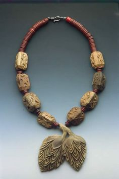 Sharon Rosenthal - necklace - vintage resin pendant, carved wood beads