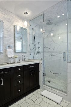 Bathroom Design. Modern Bathroom with dark stained cabinets, marble flooring and marble tiling. #Bathroom #ModernBathroom #MarbleBathroom