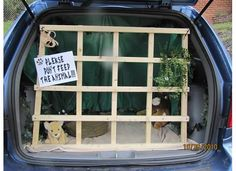 trunk or treat idea.. Maybe the dog dressed as a lion behind the bars?
