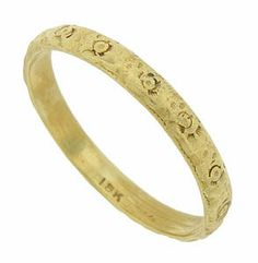 This beautiful 18K yellow gold antique wedding band is covered with a pattern of engraved florals. The Victorian wedding ring measures 2.71 mm in width. Circa: 1900. Size 7 3/4. We can re-size slightly.