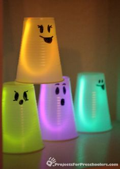 Glowing Ghosts -  Here's a quick Halloween project idea you can do with your preschooler in no time at all. This also makes a great Halloween party activity because kids of all ages can make these glowing ghosts and they are very inexpensive to make. You can make any ghost faces you'd like and even use different marker colors. Note: You do need to use permanent markers on the plastic cups.