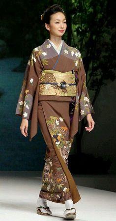 Modeling kimono and obi.  Japan
