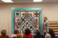 Block of the Month Quilts from Floyd and Lizzies.  Same blocks, each person added their own color.  Amazing how different each quilt looks