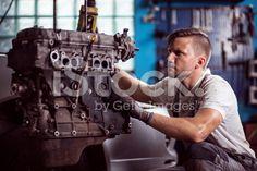 Car technician maintaining automotive engine royalty-free stock photo