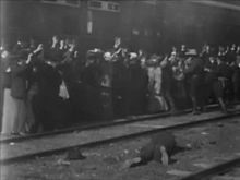 'The Great Train Robbery' (1903), directed by Edwin S. Porter, is the first film to use crosscutting, showing two scenes occurring simultaneously in different locations.