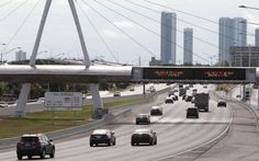 Expressways in Miami-Dade would be forced to cut tolls by 5 percent under legislation awaiting Gov. Rick Scott's signature.