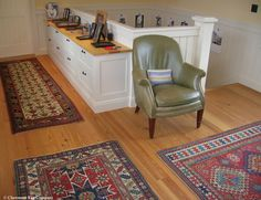 Virtuoso Triad of Collectible Caucasian Rugs Make Staircase Landing A Most Memorable Destination