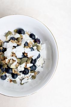 greek yogurt with granola pumpkin seeds flax seeds blueberries and coconut chips ♥