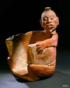 Jaina Skull Holder Maya. Jaina. clay. Seated Figure in the form of a container. It has been suggested, it may be a holder for a skull.  © Justin Kerr
