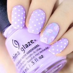 Polka Dots Design For Purple Nails. Let's discuss purple nails designs. Why are we so obsessed with this fascinating shade? Maybe because this shade is usually associated with delight, femininity, royalty, mystery, romance, passion, luxury, and wisdom. Are you ready to embrace the purple magic? Let's discover nail art in purple to keep up and feel special wherever you go. #purplenails #purplenailsdesigns #nailsdesigns #DIYNailDesigns