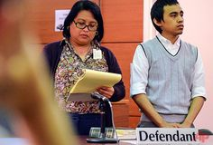 Defendant Chad Ryan DeSoto, right, listens to Judge Anita Sukola read off a list of guilty verdicts as he stands next to his public defender Jocelyn Roden at the conclusion of his trial at the Superior Court of Guam in Hagatna, Guam, on Monday, Aug. 4, 2014. A jury convicted DeSoto Monday of murdering three Japanese tourists in a crash and stabbing rampage last year that hurt 11 others. (AP Photo/The Pacific Daily, Rick Cruz)