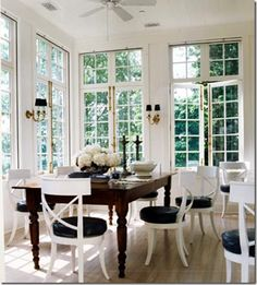 French doors and black sconces...perfect.