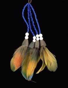 Brazil | Necklace from the Kayapo people | Feathers, mother of pearl, nuts, glass beads and cotton Arte Tribal, Tribal Art, Arte Plumaria, Tribal Jewelry, Craft Items, Fun To Be One, Stone Jewelry, Handcrafted Jewelry, Tassel Necklace