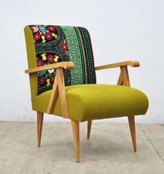 A retro style handmade wooden (arm)chair upholstered with vintage Suzani, Thai Hmong and cotton duck fabrics. Foam rubber on beech wood frame. The frame is made of kiln dried hardwood and wood arms & legs are polished nicely in natural color.  End-to-end dimensions (cm): 65 cm width x 75 cm depthx 88 cm height ; seat height 45 cm Custom orders are welcome  ** Address delivery shipping via air freight by UPS. Door-to-door delivery. ** Your name, address and phone number are required to com...