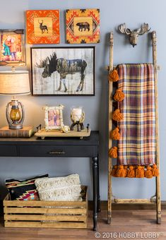 Create a fall retreat with cozy lodge decor! To DIY the scarf blanket, just add fleece lining to a scarf pattern that matches your decor and embellish with tassels.