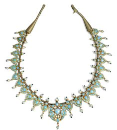 A turquoise-set and enamelled gold necklace, North India, 19th century comprising twenty-five pendants in the form of stylised blossoms with a central, larger pendant featuring facing birds, each set in the kundan technique with turquoise and mounted seed pearls, the reverse with red, green, blue and white enamel details, golden thread string with tassel terminals, fitted in custom box 90cm. completely extended 33cm. area of beads