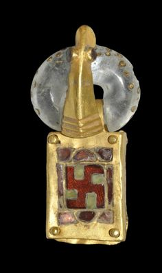 Ostrogothic Gold and Garnet Buckle with Crystal Loop, 6th century A.D. (Hitler stole this symbol, an ancient symbol of spiritual enlightenment, and reversed it to use as the Nazi symbol).