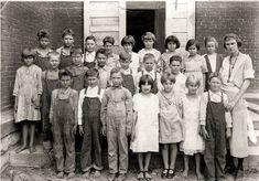 Real farm life in Foster, Missouri 1920's. The poor children, barefoot, with dirty clothes, impetigo on their little faces and the look of the school marm are classic.