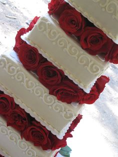 Square Wedding Cake With Top Scroll Border And Red Roses