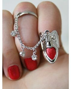 heart cut out nail ring with rhinestone chain ring- woah $16......Different, I like it