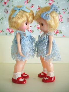 I love the brightness of these two cute little dolls. I only can see a little bit of their faces, but they look nice as far as I can tell.