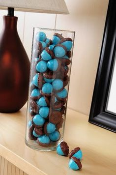 Acorns painted to use in a glass vase as decor.... how gorgeous are her colors?