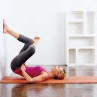 TONES BUTT * THIGHS ::: Lie on back, butt against wall, knees bent, and feet planted 3 to 4 feet up wall. Peel lower and mid back off floor and cross left ankle over right knee. Squeeze butt and front of thigh to press left knee toward wall. Do 20 pulses, then lower body and repeat on opposite side.