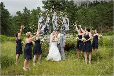 Plum Pretty Photography | Estes Park Wedding Photographer | Della Terra Wedding | Colorado Mountain Wedding | Colorado Wedding Photography | Navy Blue & Gray Wedding | Bridal Party throwing petals