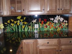 """""""Kitchen Backsplash,"""" by Liz Shepard. """"This original piece is a back splash created for my kitchen. It is made completely of hand cut stained glass."""" -- Never even thought about a stained-glass backsplash!"""