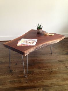 The Marquis Coffee Table is a statement piece that adds an industrial rustic feel to any living space. Live edge black walnut slab coffee table on steel hairpin legs. Heavy and substantial table that will stand the test of time.