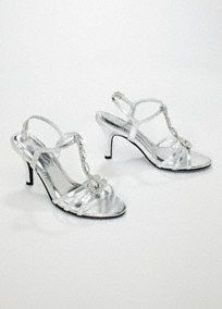 """This satin t-strap high heel sandal is one of the hottest looks of the season.   The center t-strap is entirely encrusted with marquise and pear shaped crystals.  Silver Metallic shoe adds sparkle and shine to any ensemble!  3"""" heel, leather sole. Imported."""