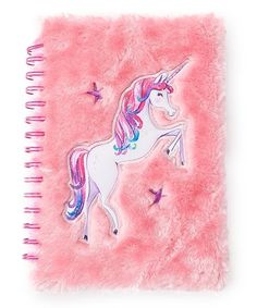 Keep track of important events and jot notes in whimsical style with this notebook boasting a colorful unicorn design and a plush fuzzy exterior. California customers, clickfor important Prop 65 information