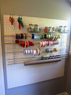 Another great craft organizer using pegboard.  She uses those circle peg tools sideways - paint the board a fun color or black