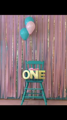 Gold pink turquoise back drop made from streamers and tablecloths. First birthday party
