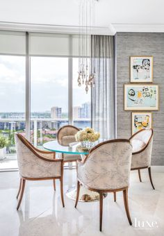 Muted Glam Dining Room with Wall art and a Miami View