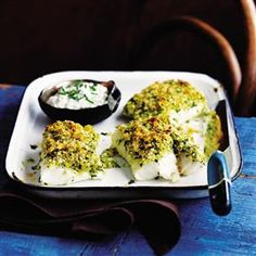 Baked fish with a herb and lemon crust recipe. Quick, light, and easy, this healthy fish supper is virtuous too if you follow our recommendation to use sustainably caught fish.