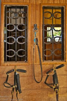 Pretty way to make use of horseshoes on barn stalls!