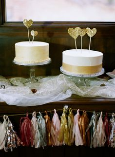 simple white cakes with gold sparkly glitter heart cake toppers | photo: cassidybrooke.com