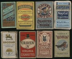 Collection of vintage cigarette packets: Wills Woodbine, Wills Gold Flake, Players Navy, Wills Capstan, Lambert and Butler Rhodian, Craven A, Black Cat and Ogden's Robin