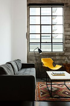 dark sofa, yellow chair - Joint Editorial Building -  Jessica Helgerson Interior Design