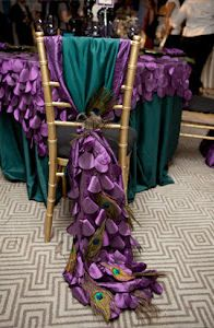 For those of you with a larger wedding budget, try using textured and scaled tablecloths with absolutely unique chair ties that drape the floor and end with a peacock feather. Take a look at this stunning wedding reception place setting…your wedding guests will be talking about this long after the event!