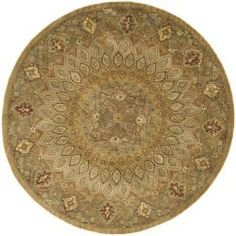 @Overstock - An intricate Oriental design and dense, thick pile highlight this handmade rug. This floor rug has a light brown background and a grey border and displays stunning panel colors of green, ivory, red and gold.http://www.overstock.com/Home-Garden/Handmade-Heritage-Medallion-Light-Brown-Grey-Wool-Rug-6-Round/6011677/product.html?CID=214117 $188.99