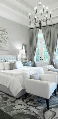Bedroom With Grey Curtains And Hanging Chandelier Ways To Installing Chandelier Lighting Check more at http://www.wearefound.com/ways-to-installing-chandelier-lighting/