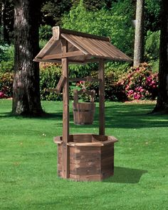 Add a rustic touch to your garden with this wishing well flower planter.