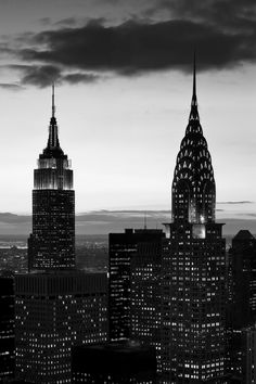 NYC night in black and white with Chrysler Building and Empire State Building.