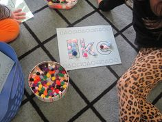 Pom pom popcorn words!  Have kids outline words that you want them to learn using fun things... like pom poms or buttons. Laminate words and use as place mats. Kids can spell words with their snacks. It's all about having fun :)
