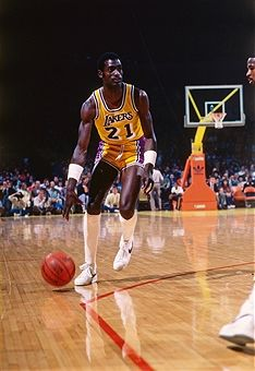 e3b112841cd Michael Cooper #21 of the Los Angeles Lakers handles the ball during a game  circa