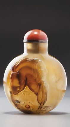 An agate 'Monk' snuff bottle possibly Imperial, Official School, Qing dynasty, Late 18th-19th century