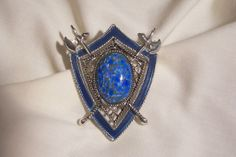 today's lovely designer arrivals Large lapis Turquoise color stone enamel double axe shield Brooch signed Star